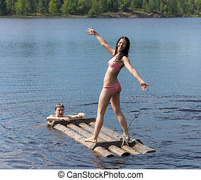 girl on a wooden raft