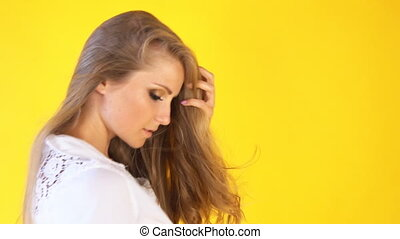 girl on a yellow background, posing for a photo shoot - gir...