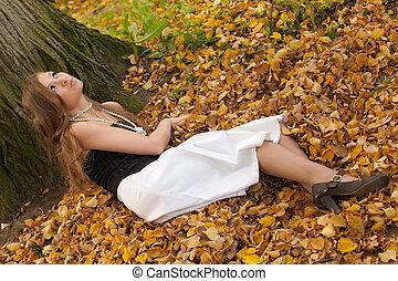 girl on autumn leaves