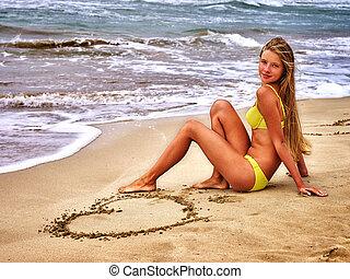 Girl on beach near the sea.