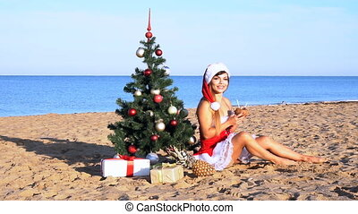 girl on beach resort in Christmas clothes for the new year...