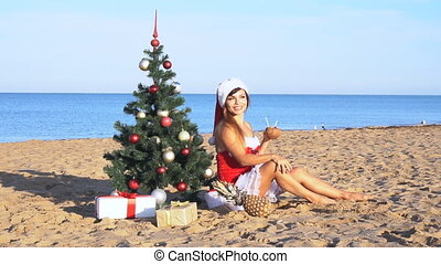 girl on beach resort in Christmas clothes for the new year