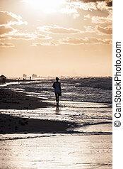 girl on beach sunset