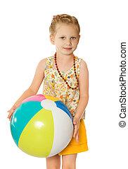 Girl on beach with ball