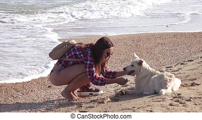 Girl on beach with dog