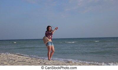 Girl on beach with phone