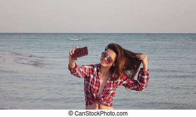 Girl on beach with phone
