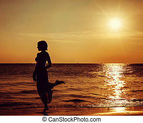 girl on beautiful beach during sunset