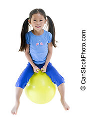 Girl on bouncing ball