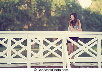 Girl on bridge
