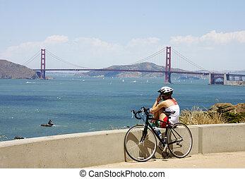 girl on cell phone near Golden gate bridge
