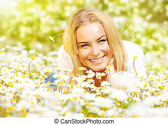 Girl on chamomile glade - Picture of pretty woman lying down...