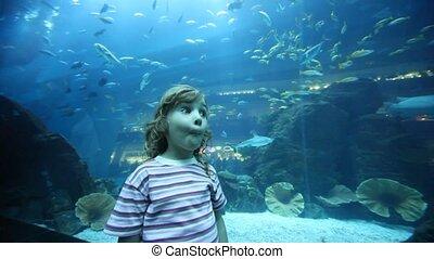 girl on close shot standing in oceanarium