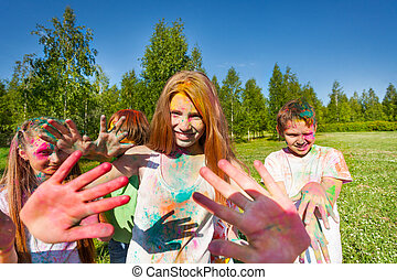 Girl on color festival smeared with colored powder -...
