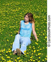 Girl on dandelion lawn