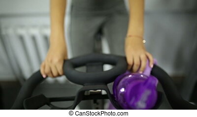 Girl on exercise bike at the gym