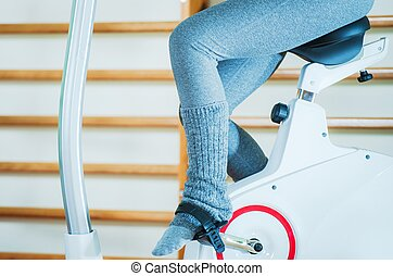 Girl on Exercise Bike