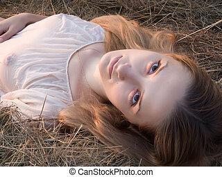 girl on fresh hay