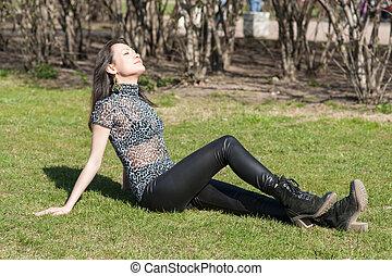 girl on green spring grass