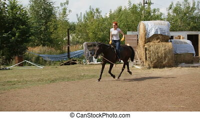 Girl on horse receives lesson of horse riding - equestrian sport, slow-motion