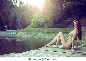GIrl on lake wearing monokini.