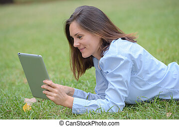 girl on laptop on grass