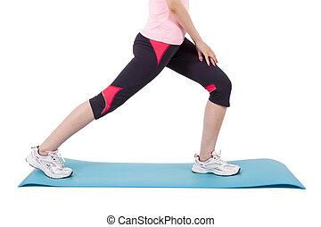 girl on mat doing leg exercises