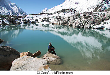 Girl on mountain lake
