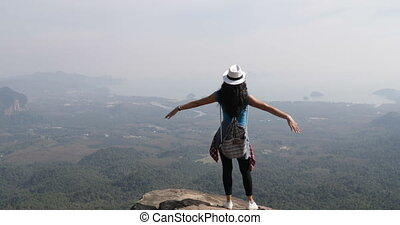 Girl On Mountain Top Raise Hands Looking At Beautiful...