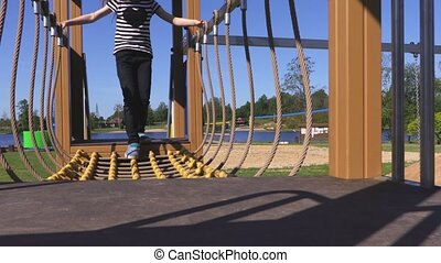 Girl on obstacle course in playground