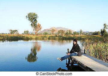 girl on pier at lake