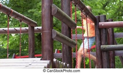 Girl on playground in park