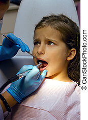 girl on reception at the dentist - frightened girl on...