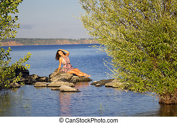 Girl on river coast