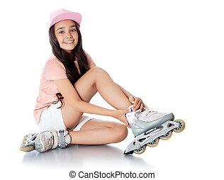 girl on roller skates - Charming dark-haired girl of school...