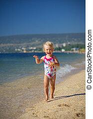 Girl on sea coast