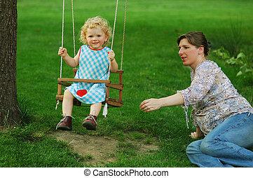 Girl on seesaw