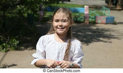 Girl on seesaw - Eight years old girl enjoying on seesaw on...