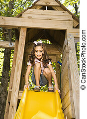Girl on slide.