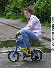 girl on small bicycle