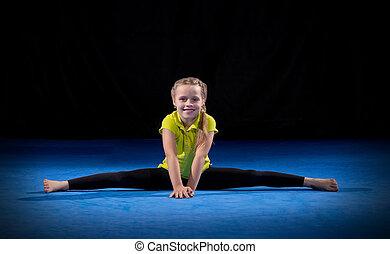 Girl on sport mat