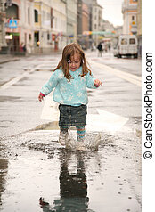 girl on street in puddle