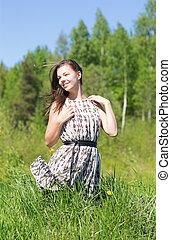 girl on summer grass