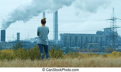 Girl on the background Industry Pipes Pollute the Atmosphere With Smoke