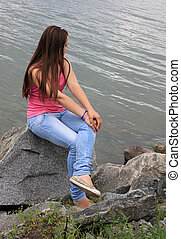 Girl on the banks of the river