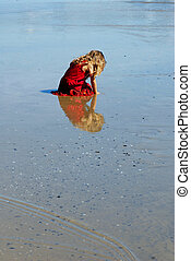 Girl on the beach dressed in red