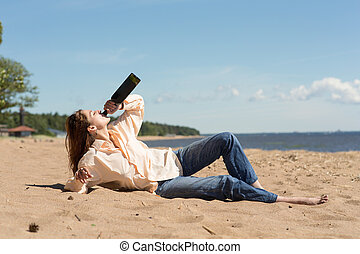 girl on the beach drinking wine
