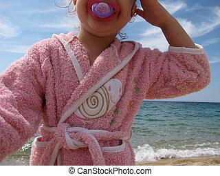 girl on the beach in Greece