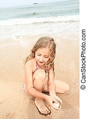 girl on the beach in summer