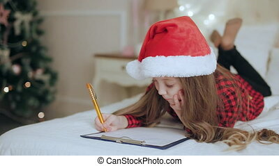 Girl on the bed hat Writing A Letter To Santa